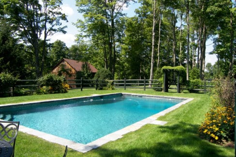 Pool-with-blue-stone-&-split-rail-fencing-in-Waccabuc,-NY