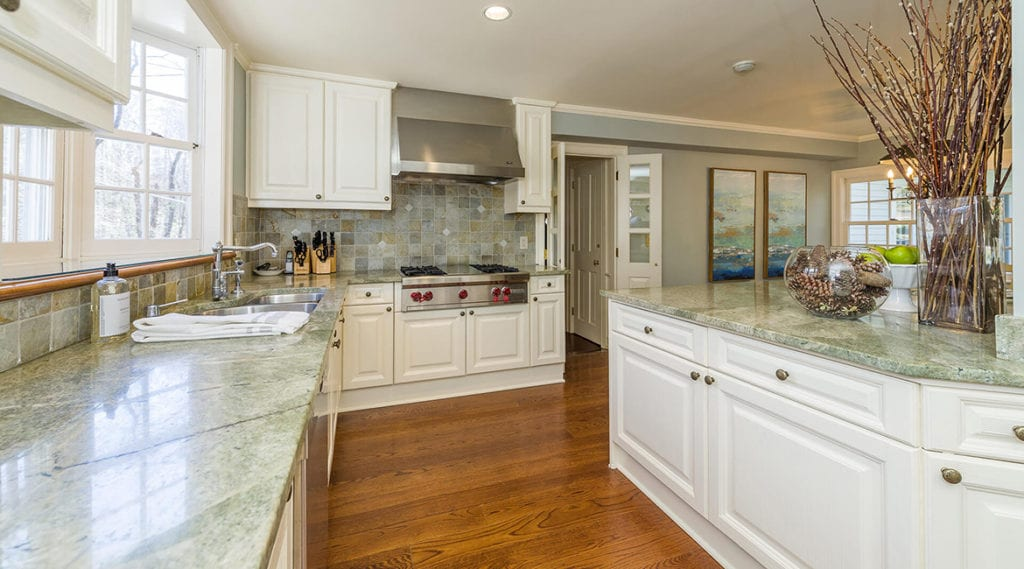 Modern-country-kitchen-with-Granite-countertop-complimenting-the-tile-backsplash-in-North-Salem-NY-